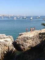 Kids jumping into Baia de Cascais.