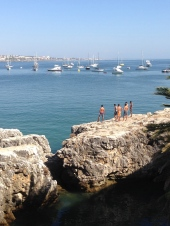 Kids jumping into Baia de Cascais.