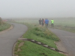 Morning joggers at Zaanse Schans. Corey mentioned that it's rare to see such a large group of men running together. What do you think?