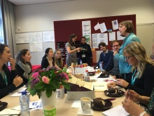 Staff meeting and discussion over sweets