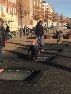Trampolines on the sidewalk!