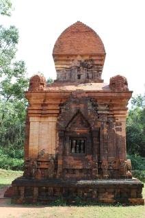 New bricks rebuild the temple site.