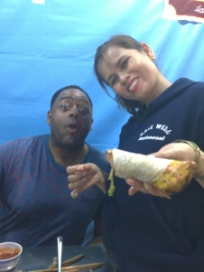 Bale Well staff models how to make a wrap and then feeds you your first bite!