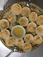 Banh Beo: take a small spoonful of sauce and ladle over a small dish, then use the same spoon and scoop out of the dish.