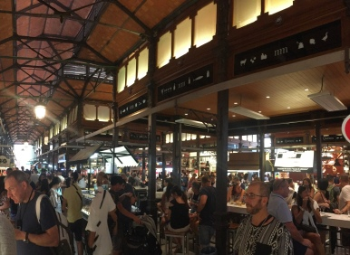 Pick your passion at the market! So many people saddled up sharing tapas and wine