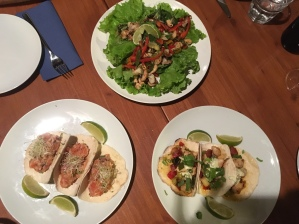 Salmon tacos, chorizo tacos and a chicken and cashew salad.