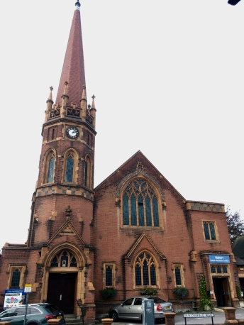 A red brick church around the corner from St Albans City Station.