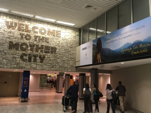 It's hard to see but Mandela is on the billboard welcoming guests to the airport.