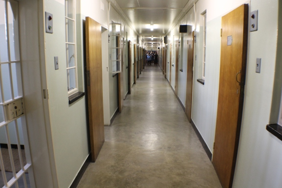 Mandela's cell is fourth on the right of this long corridor