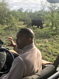 Explaining that Rhinos can be easier to track because they create a toilet in their territory. Rhinos will always use the facilities in the same place, and sweep dirt over like a dog might.