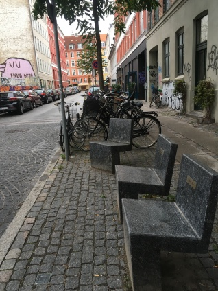 Artistic benches and chairs throughout the city