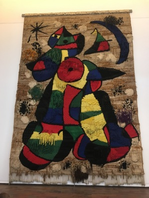Woven tapestry with Royo.