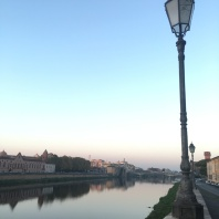 Walking over the Arno to Pisa Centrale for the 7am train.